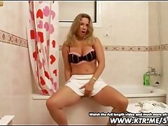 dilettante golden-haired wife toying in bath