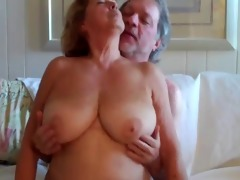 large boobed older woman rides her spouse 2