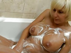 playful blond mother i with big bosom plays