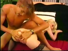 tiny youthful golden-haired sucks on a large rod