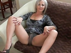 impressive blond momma in hose does striptease