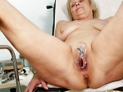 dirty blond granny gets her twat gaped at gyno