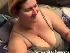 emily 39 years with large mambos plays at home