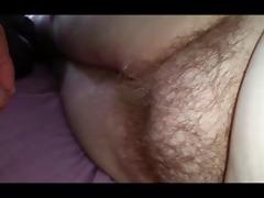 rubbing the wifes chubby hirsute slit laying on