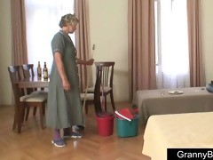 youthful boy bangs older cleaning lady