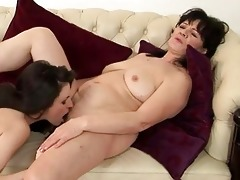 chubby dark brown mama and juvenile chick having