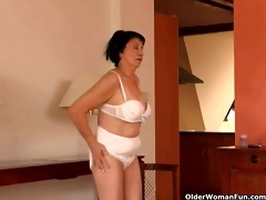 over 60 granny does striptease and masturbates