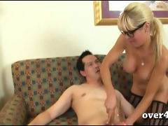 sexy mother i with glasses gives a cook jerking