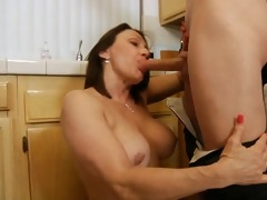 breasty housewife copulates in the kitchen