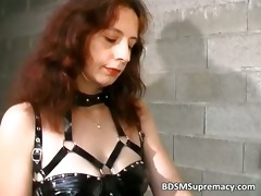 ribald redhead dominatrix-bitch dominates this