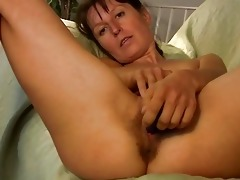 slim brunette hair milf in red undies plays with