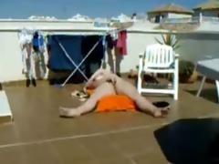 my nice-looking mom sunbathing and masturbating.