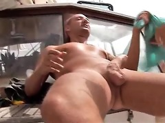 blond gives a fellatio on the boat