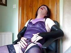 aged crossdresser in purple underware masturbates