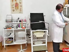 redhead older widens her legs at fetish clinic