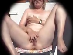 blonde caroline fingering in the backyard