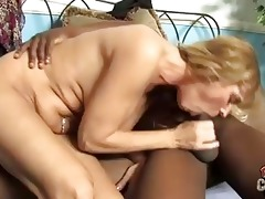 golden-haired momma with large happysacks sucking