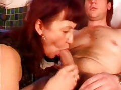 mature redhead with darksome nylons sucks shlong
