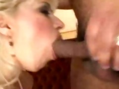gorgeous blonde rides a large rod
