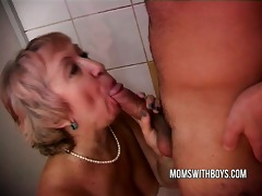 old whore and youthful dude in shower act